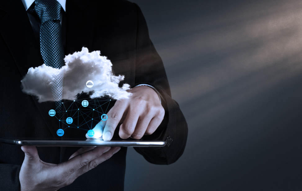 Businessman-hand-working-with-a-Cloud-Computing-diagram